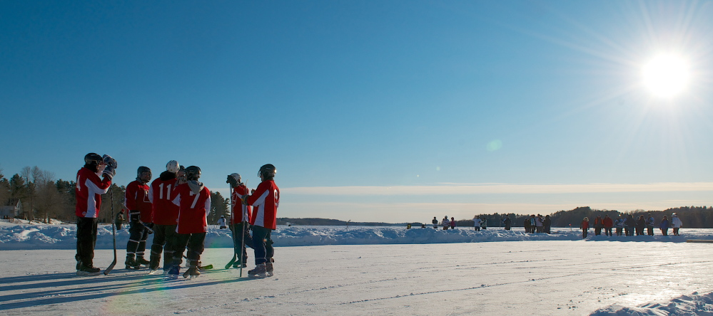 After this strategy session, just four of these players took to the ice unmarked by any red or blue lines last year during the second annual Maine Pond Hockey Classic in China Lake. Teams skate four aside and try to put the puck into a wooden box. This year's tournament will be held in February at Messalonskee Lake in Sidney.