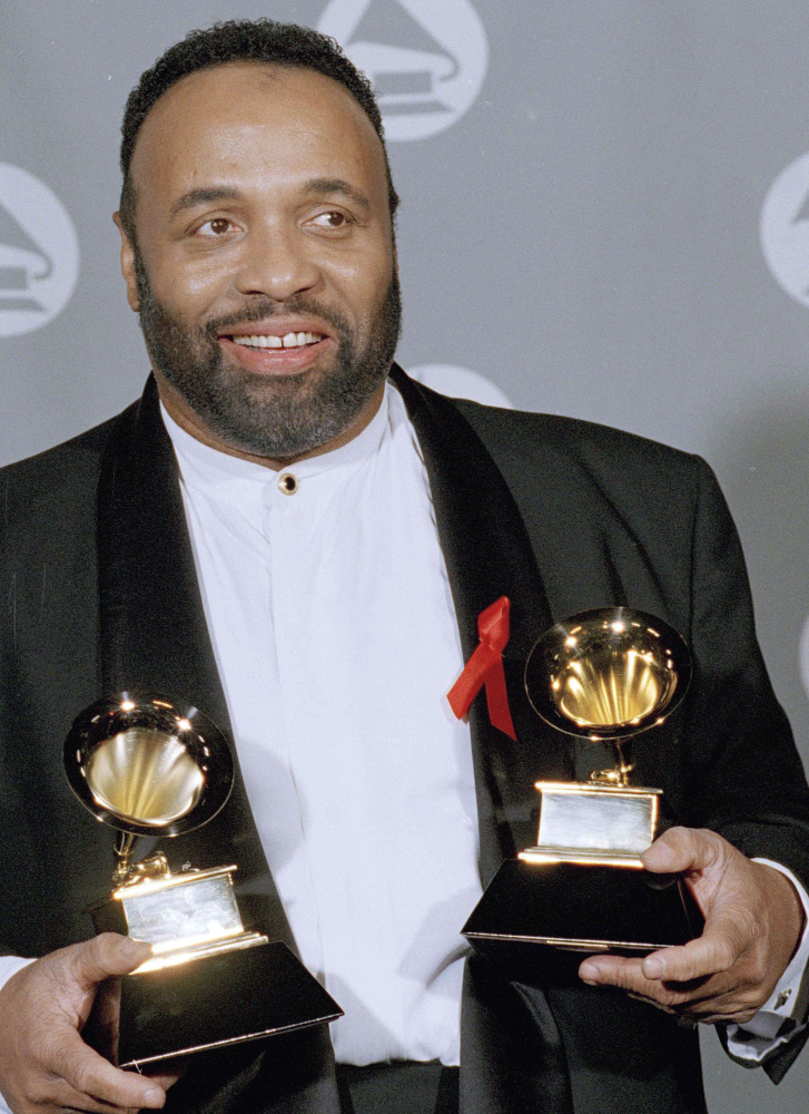 Andrae Crouch displays his two Grammys in 1995. He was a major force in contemporary gospel music.