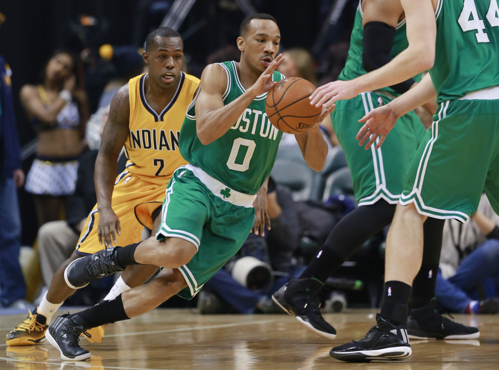 Boston Celtics guard Avery Bradley receives the ball from center Tyler Zeller while Indiana guard Rodney Stuckey, left, pursues Bradley during the first half of Friday's game in Indianapolis.