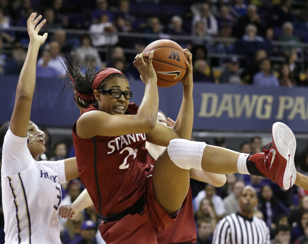 Erica McCall of Stanford grabs a rebound in front of Washington's Talia Walton during their game Friday night in Seattle.