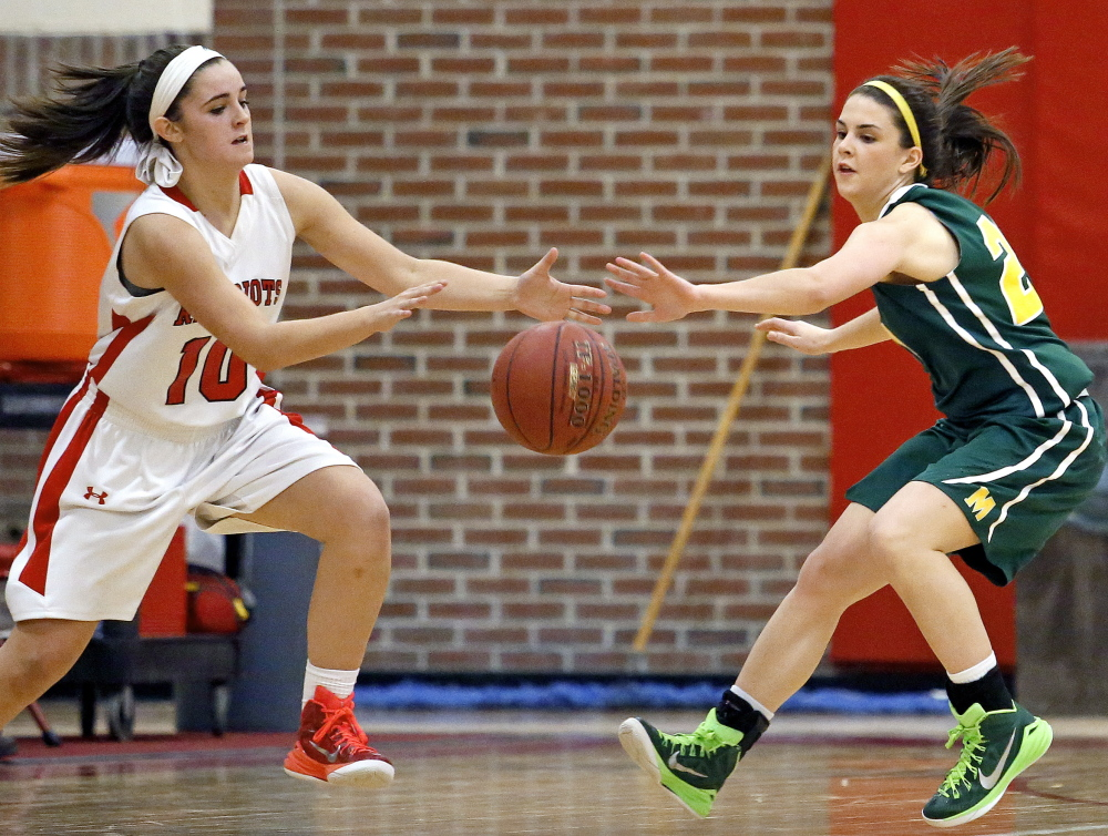 The ball is there for the taking, and Lydia Henderson of South Portland left, and Olivia Dalphonse of McAuley look to take it Friday night during their SMAA game at Beal Gym. Dalphonse's defense on Henderson was one of the keys as the Lions improved their winning streak to nine with a 45-36 victory.