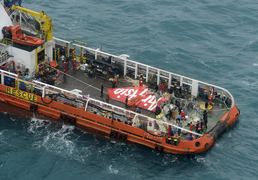 A portion of the tail of AirAsia Flight 8501 is seen on the deck of a rescue ship after it was recovered from the sea floor on the Java Sea, on Saturday.