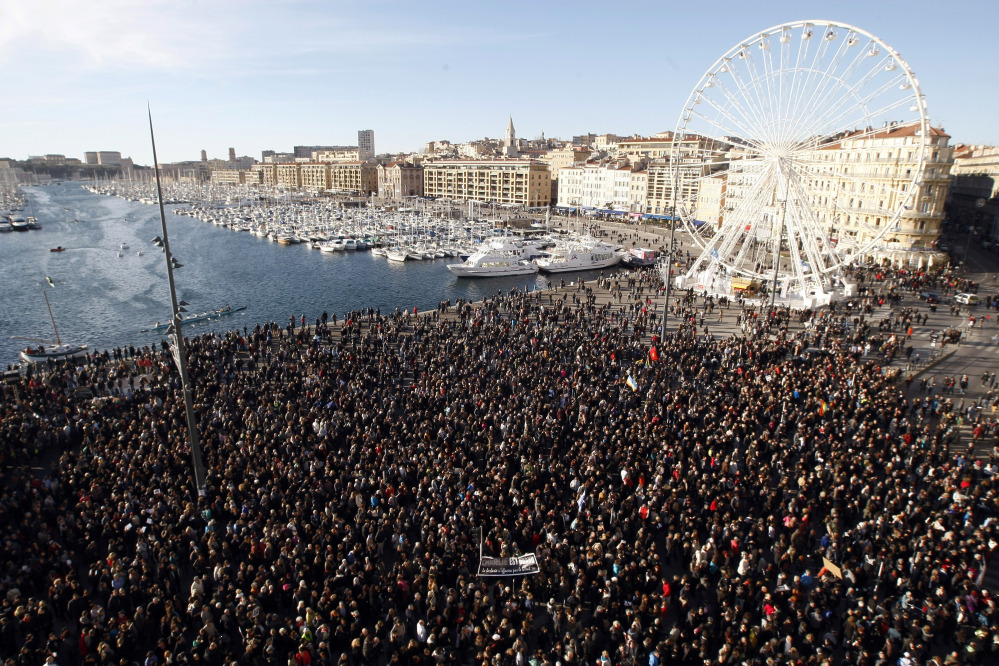 Thousands of people attend  a demonstration in solidarity with the victims of terrorist attacks in and around Paris linked to Wednesday's attack on French satirical newspaper Charlie Hebdo at the Old-Port of Marseille, southern France, on Saturday.