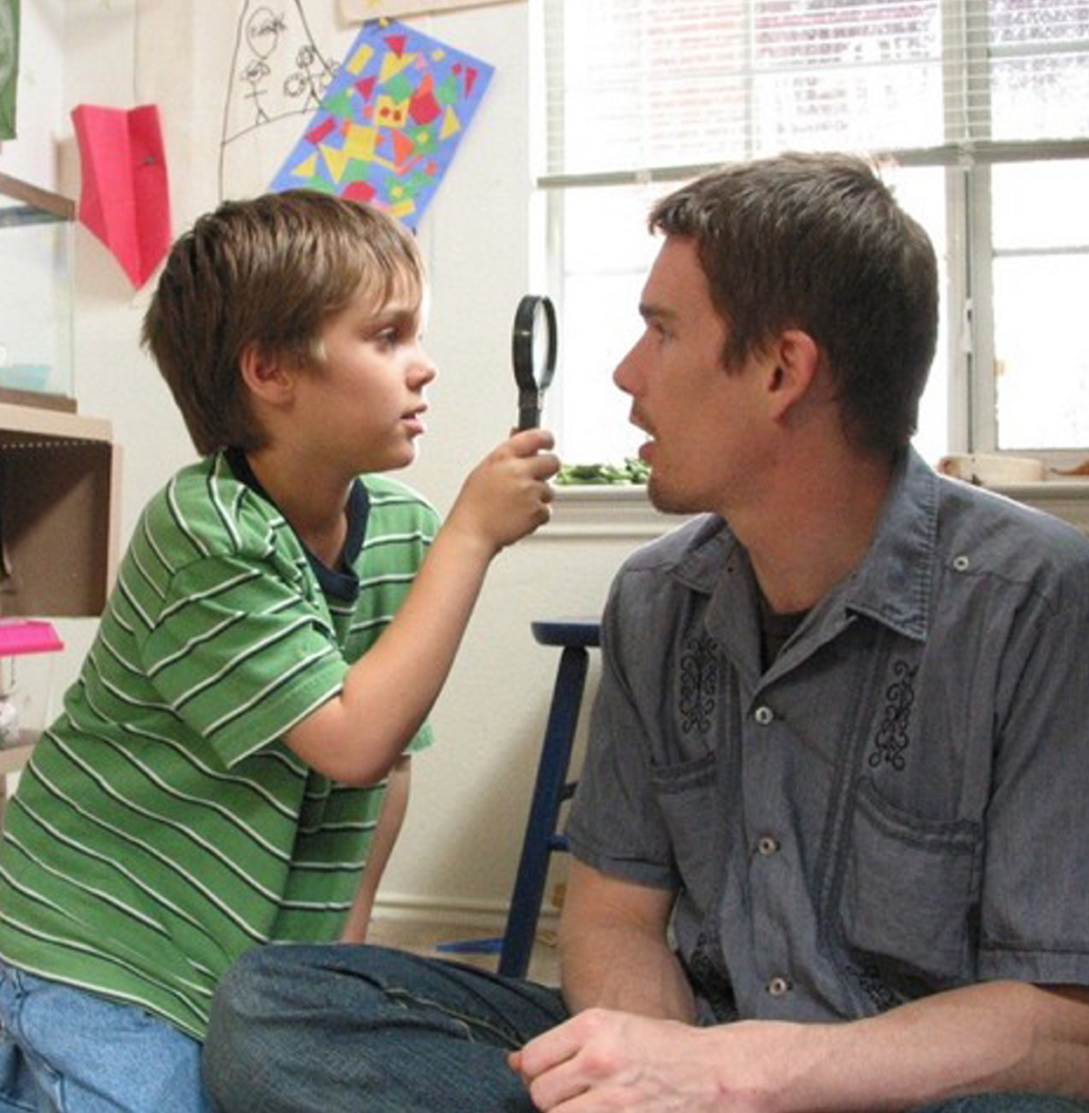 "Ellar Coltrane and Ethan Hawke in ""Boyhood."""