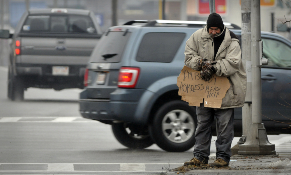 A panhandler asks for help at an intersection in Worcester, Mass., in 2013. The U.S. Supreme Court could decide to hear a challenge by the American Civil Liberties Union regarding a pair of 2013 panhandling ordinances.