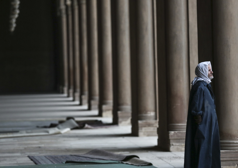 An Egyptian Muslim pauses inside Ibn-Tulun Mosque in Cairo. After the attack in Paris, there is increasing talk within Islam about whether to reject a radical minority that some fear is dragging them into conflict and ruining the faith.