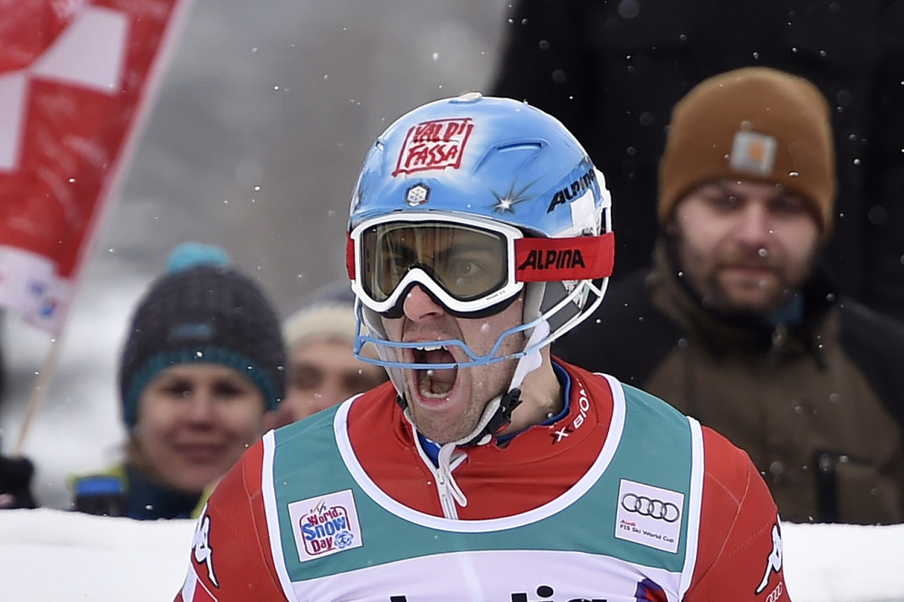 Stefano Gross of Italy celebrates his victory after the second run of the men's slalom FIS World Cup race in Adelboden, Switzerland, on Sunday.