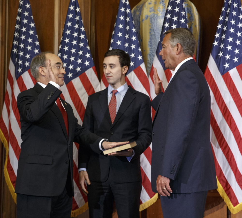 U.S. Rep. Bruce Poliquin, R-Maine, left, with his son, Sam, center, stands with House Speaker John Boehner for a ceremonial swearing-in and photo-op last week.