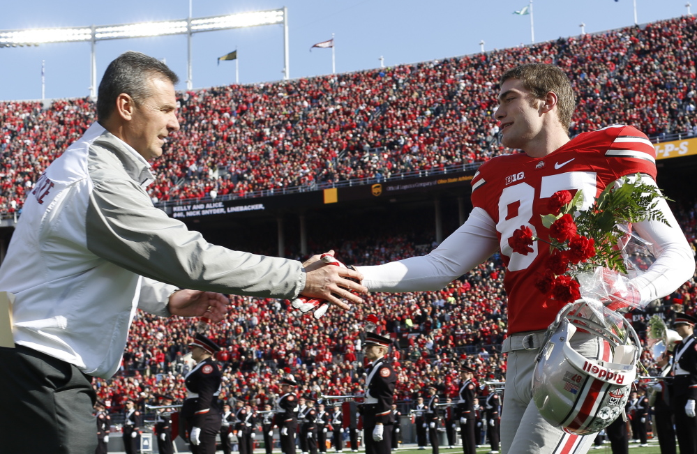 Cheverus graduate Peter Gwilym, a walk-on at Ohio State, shakes hands with Coach Urban Meyer on Senior Day, Nov. 29.