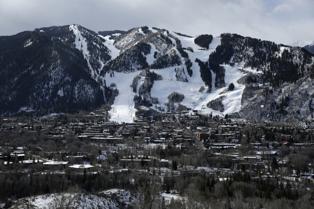This Dec. 1, 2014 photo shows the Aspen Mountain ski area by Aspen, Colo. Resort towns like Aspen dramatically demonstrate an unnerving trend: Across the country, the rich are getting richer while the rest of the country is essentially treading water.