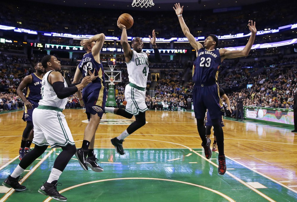 Boston Celtics guard Marcus Thornton drives to the basket between New Orleans Pelicans forwards Anthony Davis (23) and Ryan Anderson (33) during the first quarter of Monday night's game in Boston.