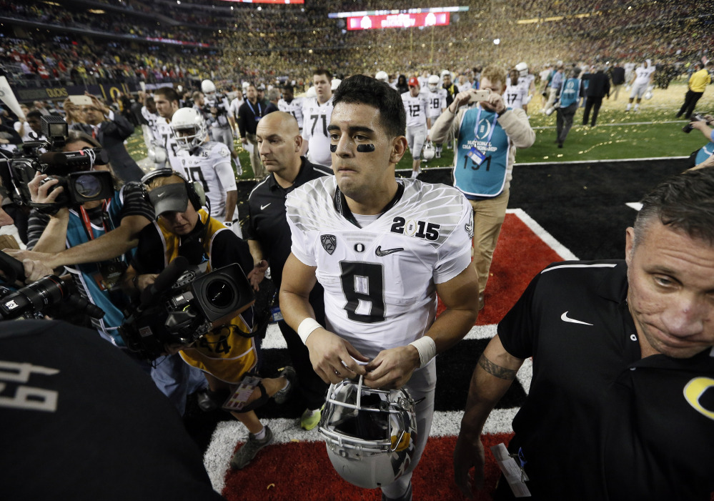 Oregon quarterback Marcus Mariota walks off the field after Monday night's championship game against Ohio State. It likely was Mariota's last college game, as he likely will enter the NFL draft.