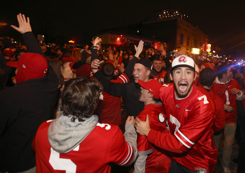 Ohio State fans block High Street in Columbus, Ohio as they celebrate the Buckeye's 42-20 win over Oregon following the National Championship football game between Ohio State and Oregon, in Columbus, Ohio, Monday.