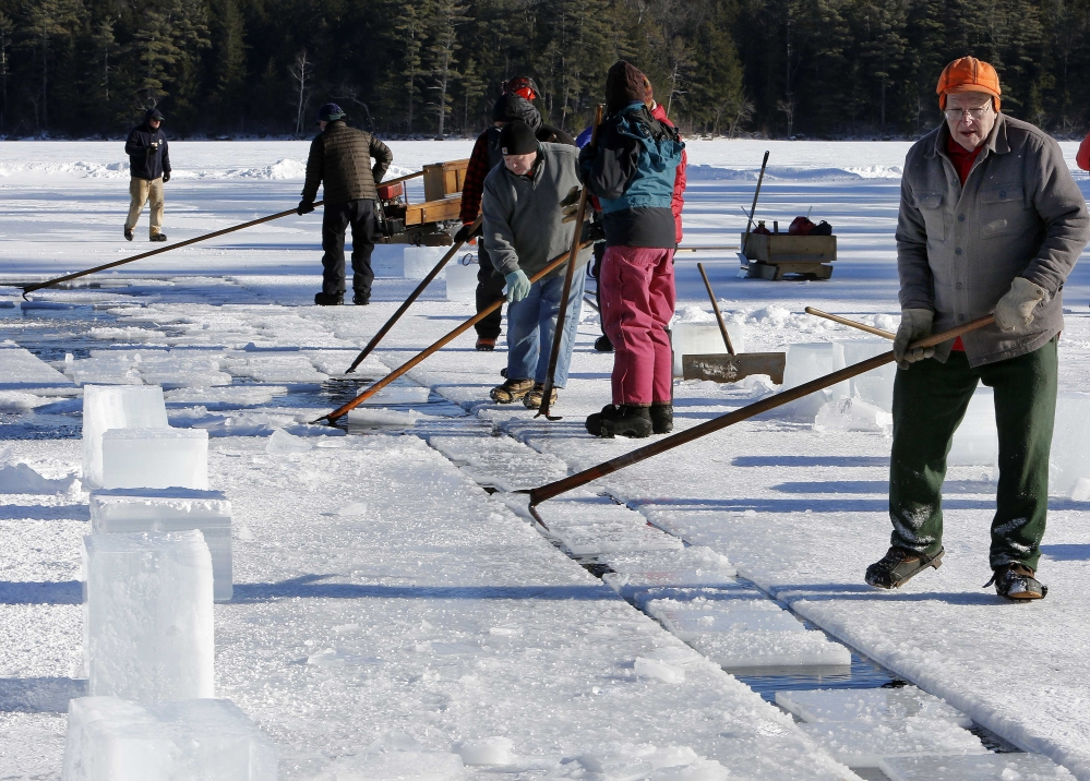 Norman Lyford, 88, guides blocks of ice from Squam Lake on Tuesday in Sandwich, N.H. Organizers honored him for his 70th year of taking part.