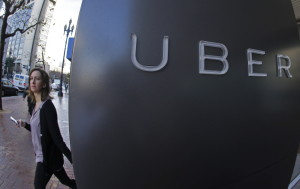 A woman leaves Uber headquarters in San Francisco. The company will now share data on travel patterns.