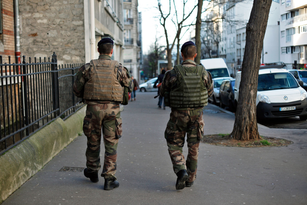 French soldiers secure the perimeter of a Jewish school in Paris on Wednesday as part of the highest level of security after last week's attacks by Islamist militants. France has deployed thousands of police and soldiers around the country.