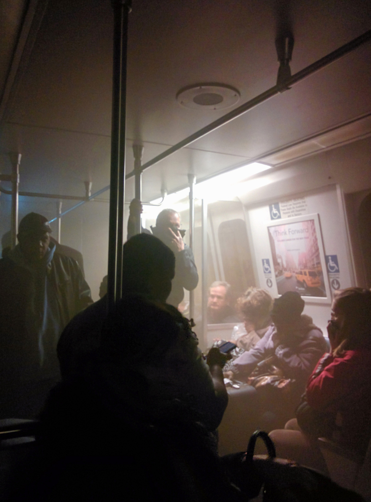 Smoke fills a Washington Metro system subway car near the L'Enfant Plaza station in Washington, Monday.