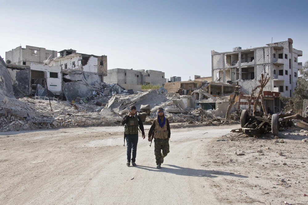 The Islamic State group is losing its grip on the Syrian border town of Kobani under intense U.S.-led airstrikes and astonishingly stiff resistance by Kurdish fighters. The Associated Press