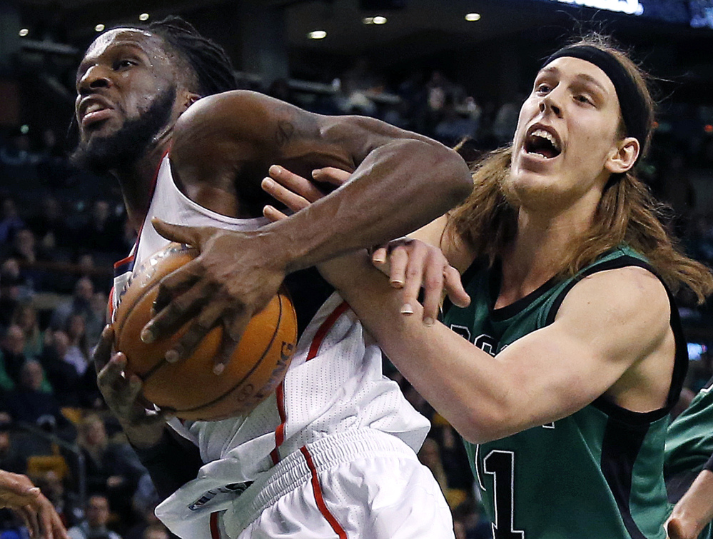 Atlanta Hawks forward DeMarre Carroll grabs a rebound away from Celtics center Kelly Olynyk during the first half of Wednesday night's game in Boston. Carroll scored 22 points in the game.