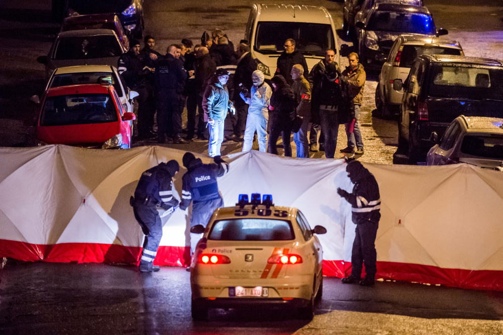Police investigate a shootout in a street in Verviers, Belgium, on Thursday, in which police say they killed two terror suspects.