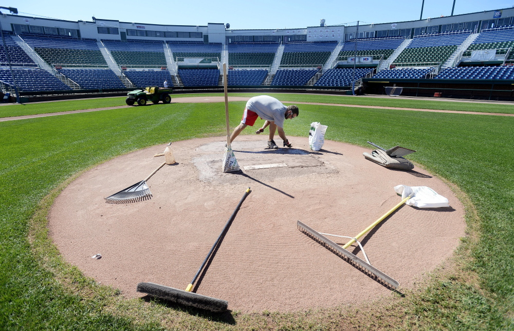 Assistant head groundskeeper Jason Cooke grooms the mound in September at Hadlock Field, which will get a pitching clock next season as baseball tests a way to speed up the ever-lengthening duration of major league games, which now averages 3 hours, 8 minutes.