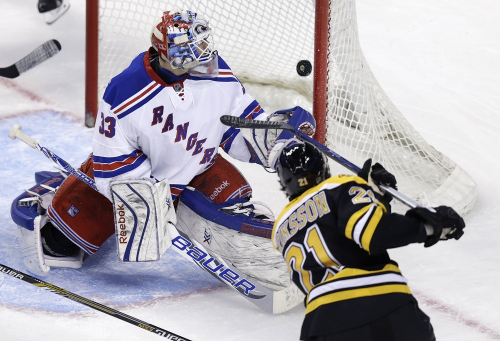 New York Rangers goalie Cam Talbot watches as a shot by Boston Bruins left wing Loui Eriksson passes the post for a goal during the third period of Thursday night's game in Boston. The goal gave Boston a 3-0 lead.