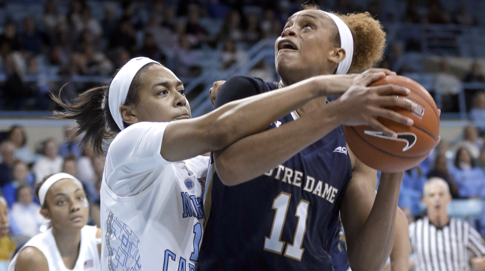 Notre Dame's Brianna Turner is pressured by North Carolina's Allisha Gray during the second half of their game in Chapel Hill, N.C., on Thursday night. Turner had 29 points and a career-high 18 rebounds as Notre Dame won, 89-79.