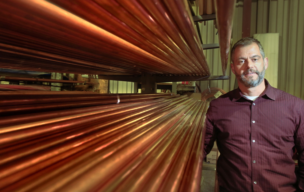 Nate Bassett, a plumbing supplier, says copper costs are down 12 percent since August.
