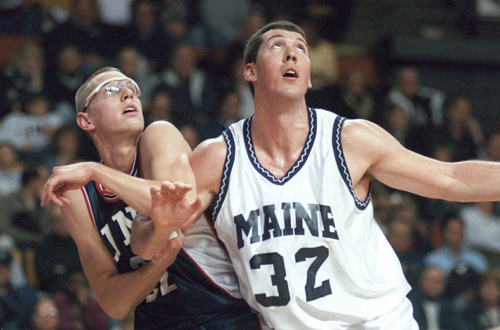 UNH's Austin Ganley battles with UMO's Nate Fox for rebounding position in this game photo from January 2000.