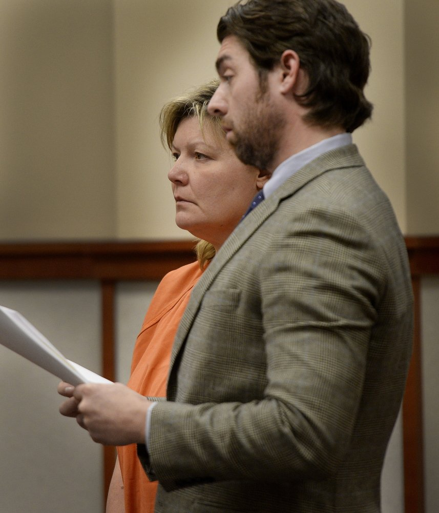 Amey Molloy appears for a hearing at the Cumberland County Courthouse in Portland with her attorney John D. Clifford V on Friday. Molloy faces theft charges in Massachusetts for allegedly defrauding the One Fund Boston.