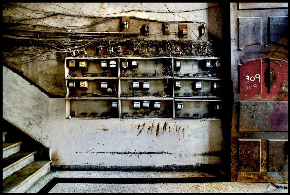 Illegally wired panels, constructed to provide free electricity to occupied abandoned buildings in Cuba, are the subject of Caras' latest series of photos.