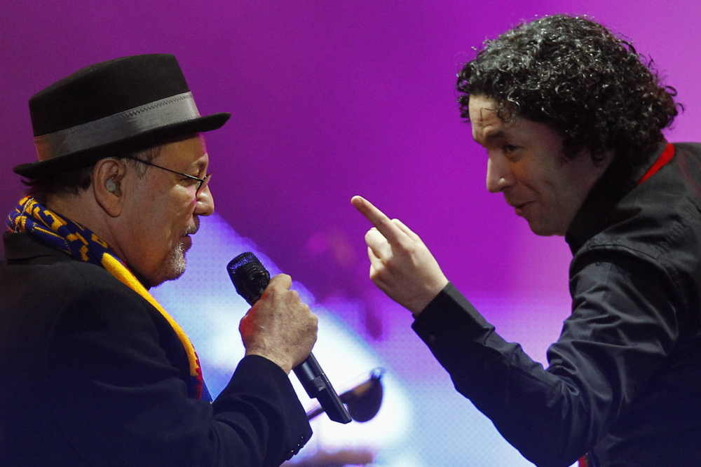 Venezuelan conductor Gustavo Dudamel, right, performs with Panamanian singer Ruben Blades.