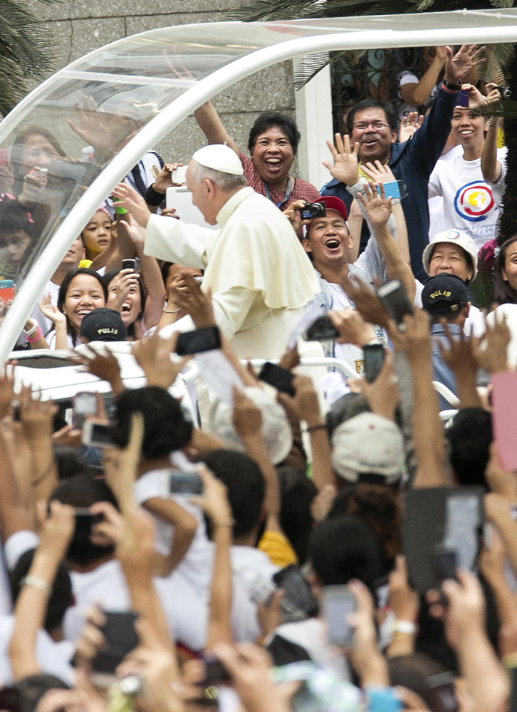 Thousands of Filipinos welcome Pope Francis upon his arrival at the Cathedral Basilica of the Immaculate Conception in Manila on Friday.