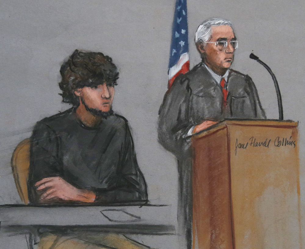 Boston Marathon bombing suspect Dzhokhar Tsarnaev, left, is depicted beside U.S. District Judge George O'Toole Jr., right, this month in a courtroom sketch.