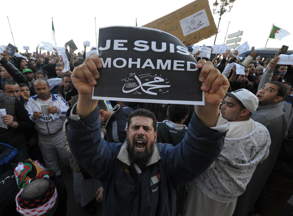 A man expresses his anti-Charlie Hebdo feelings during a protest in Algiers, Algeria, Friday. Elsewhere in Africa, four people died in a protest in the former French colony of Niger.