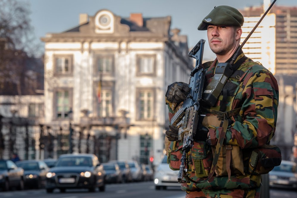 A Belgian para-commando patrols near the office of the prime minister in Brussels, on Saturday.