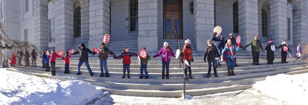 Anti-abortion activists ring the State House on a frigid Saturday in Augusta.