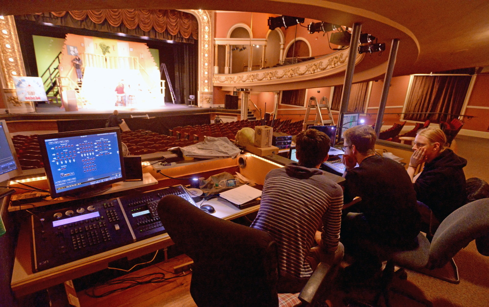 Sound and lighting technicians Logan Bard, from left, River Massey and Isaac Woods work on the lighting and sound equipment Saturday at the Waterville Opera House. The 800-seat hall is also a listening room, its marketing and development director says.