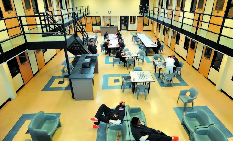Inmates read and play board games in the day room in the medium security wing at the Somerset County Jail in East Madison. While some jails are crowded, others have room to spare.