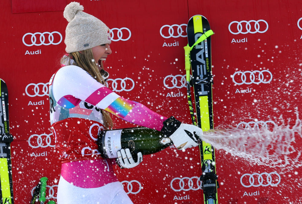 Lindsey Vonn sprays sparkling wine as she celebrates on the podium after winning the women's World Cup downhill in Cortina d'Ampezzo, Italy, on Sunday.