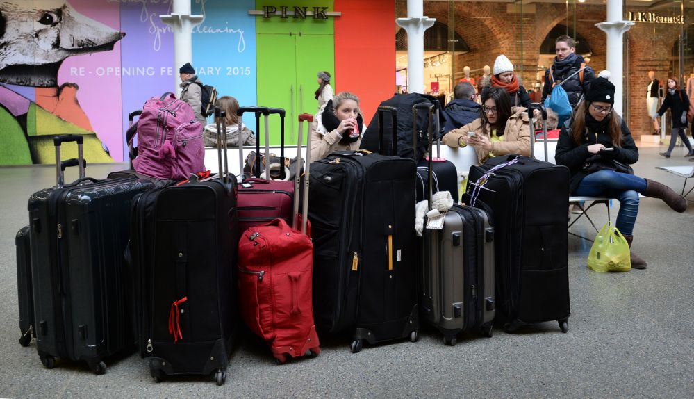 Commuters wait at St Pancras station in London, as Eurotunnel services have resumed but customers are told to expect delays, on Sunday.
