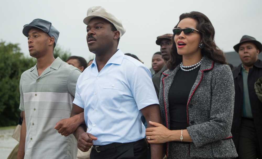 "David Oyelowo, center, plays Martin Luther King Jr. and Carmen Ejogo portrays Coretta Scott King in ""Selma."""