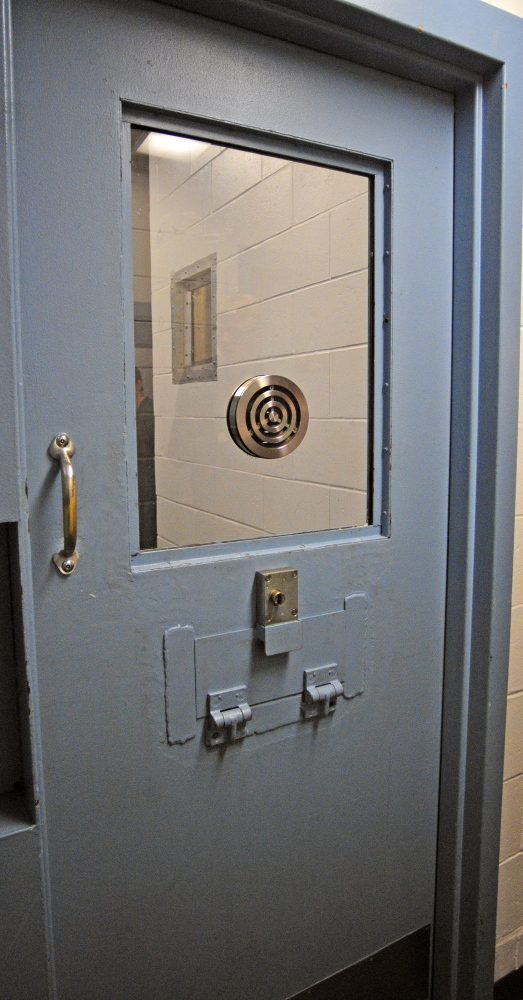 This cell has been modified with a large slot in the door so that meals can be passed in without having to enter it at the Kennebec County Jail in Augusta. County jails in Maine are facing overcrowding and other challenges.