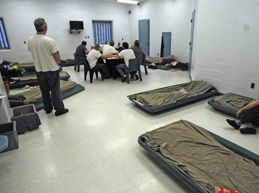A classroom has been converted to housing with cots on the floor at the Kennebec County Jail in Augusta.