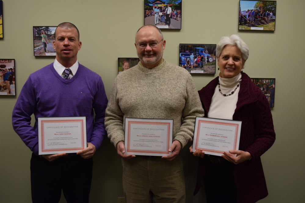 From left, Wells High School Principal Jim Daly, Wells Junior High School Principal Chris Chessie and Wells Elementary School Principal Marianne Horne received certificates of recognition from the Wells-Ogunquit Community School District School Committee for their guiding roles in helping their schools receive a high ranking among public schools in Maine in the 2015 Niche Rankings. Photo courtesy Reg Bennett