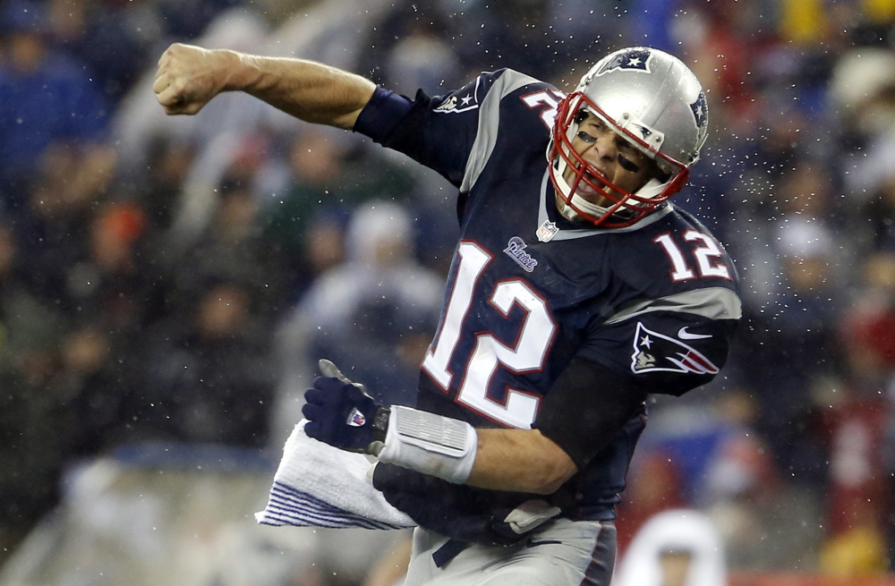 Quarterback Tom Brady celebrates after one of three Patriots touchdowns in the third quarter that put the game away against the Colts at Gillette Stadium. New England won with a combination of a strong running game, tricky formations and an unpredictable pass defense.