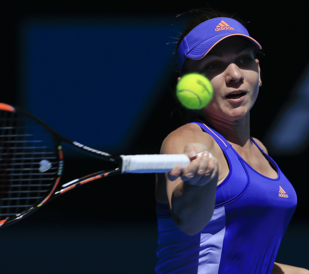 No. 3 seed Simona Halep hits a return during her 6-3, 6-2 win over Karin Knapp in the first round of the Australian Open in Melbourne, Australia.