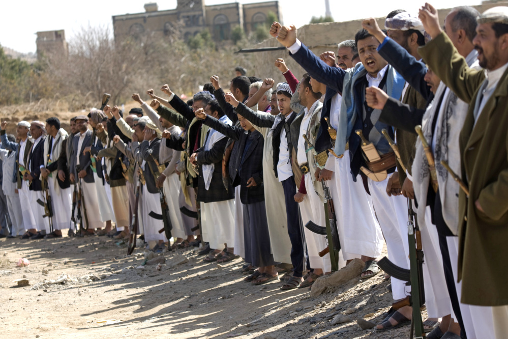 Houthi Shiite Yemeni chant slogans during clashes near the presidential palace in Sanaa, Yemen, on Monday. Rebel Shiite Houthis battled soldiers near Yemen's presidential palace and elsewhere across the capital Monday, despite a claim of a cease-fire being reached to halt the violence, witnesses and officials said.