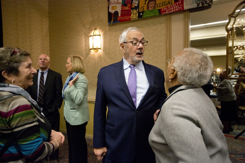 Former U.S. Rep. Barney Frank greets Anita Talbot of Portland after the annual MLK Jr. Day breakfast hosted by the NAACP at the Holiday Inn by the Bay on Monday in Portland.