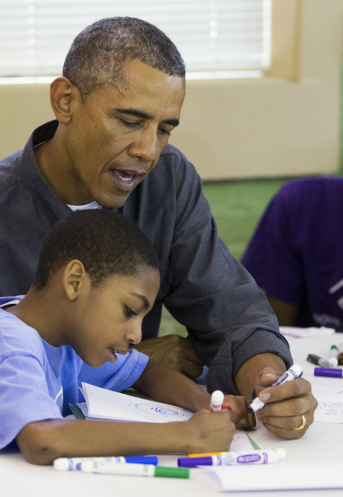 President Obama helps out Monday at the Boys & Girls Club in Washington, D.C.